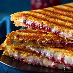 Panini with Brie, Cranberry Sauce and Caramelized Onions